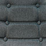 Buttoned chair back support detail. Gray fiber material texture Royalty Free Stock Images