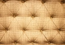 Buttoned on the gold Texture. Royalty Free Stock Photos