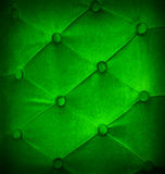 Buttoned on green light texture sofa repeat background. Stock Photo