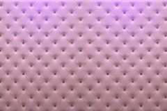 Buttoned pink leather wall. With vignetting on padding background Royalty Free Stock Photography