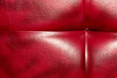 Buttoned on the red Texture. Repeat pattern.  Stock Images