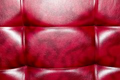 Buttoned on the red Texture. Repeat pattern.  Royalty Free Stock Image