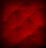 Buttoned on red texture sofa repeat background. Stock Image