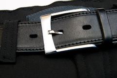 Buttoned strap. On black jeans Stock Images