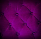 Buttoned on violet texture sofa repeat background. Royalty Free Stock Images