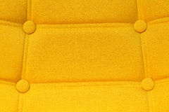 Buttoned yellow chair back support detail. Buttoned chair back support detail, yellow fiber material texture Royalty Free Stock Photos