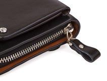 Buttoned metal zipper on the bag. Buttoned zipper bag krupnіm up on a white background Stock Images