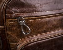 Buttoned zipper on a leather bag for men. Slider Royalty Free Stock Photo