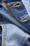 Buttonhole closure. Close buttonhole closure of a blue jeans Stock Photos