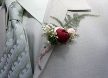 Buttonhole wedding. Flowers  red rouse Royalty Free Stock Photography