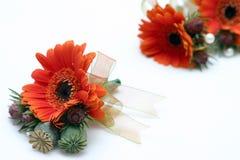 buttonholes pomarańcze ribboned obrazy stock