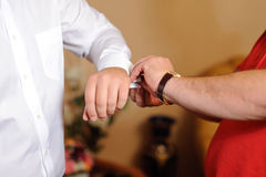 Buttoning Cuff Link Stock Images