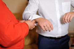 Buttoning Cuff Link Stock Image
