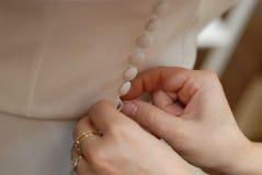 Buttoning a dress Stock Photos