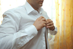 Buttoning Shirt Royalty Free Stock Images
