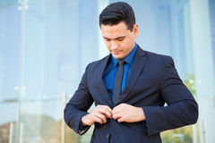 Buttoning a suit Stock Image
