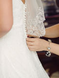 Buttoning Wedding Dress Stock Images