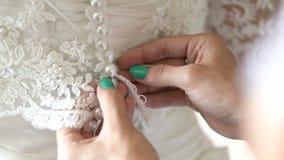 Buttoning wedding dress stock video footage