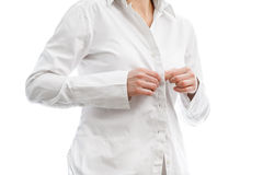 Buttoning a white shirt. Buttoning a fresh, white shirt, on plain white background Stock Photos