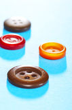 Buttons. Some multicolored buttons over blue Royalty Free Stock Image