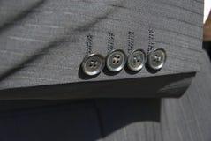 Buttons. A set of four sleeve's button Stock Photos