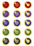 Buttons. Festive buttons in many colors with gold borders and hearts Royalty Free Stock Photography