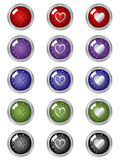 Buttons. Festive buttons in many colors with silver borders and hearts Stock Photography