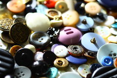 Buttons. Many colorful, variously shaped buttons - closures for clothing - are presented and used as background Royalty Free Stock Photos