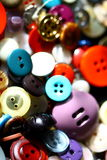 Buttons. Many colorful, variously shaped buttons - closures for clothing - are presented and used as background royalty free stock photo