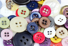 Buttons. Tailoring buttons of various colors and styles for background Stock Image