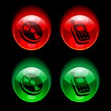 Buttons. Red and green glossy buttons with pictograms of cd disc and mobile phone Stock Photos