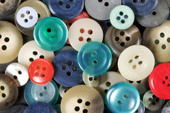 Buttons. A collection of various sized and colors of used buttons Royalty Free Stock Image