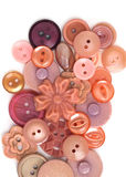 Buttons. A selection of old pink and flsh-colored buttons royalty free stock photo