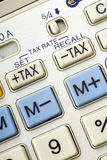 Buttons. Tax buttons on a pocket calculator - closeup Royalty Free Stock Images