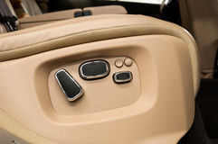 Buttons for adjusting seat position. Stock Photos
