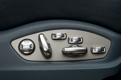 Buttons for adjusting seat position. Royalty Free Stock Image