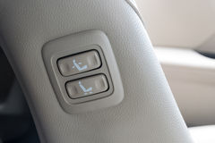 Buttons for adjusting seat position. Royalty Free Stock Photos