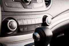 Buttons of air conditioner control in modern car stock photos