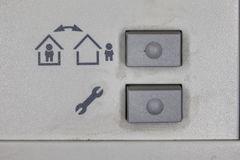 Buttons on the alarm in the apartment stock image