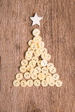 Buttons as decorative Christmas tree on wooden Royalty Free Stock Photos