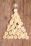 Buttons as decorative Christmas tree on wooden Royalty Free Stock Image