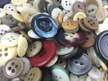 Buttons. Assorted buttons filling the frame Stock Photo
