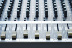 Buttons of auido mixer board, warm tone. Buttons of auido mixer board Royalty Free Stock Photos