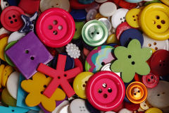 Buttons background. Colorful variety of buttons for a sewing background Royalty Free Stock Photography