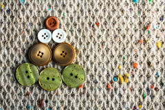 Buttons on the background knitted scarf Stock Image