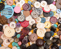 Buttons. A background or texture of a wide variety of clothing buttons Stock Images