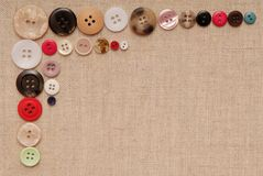 Buttons are on beige canvas Royalty Free Stock Image