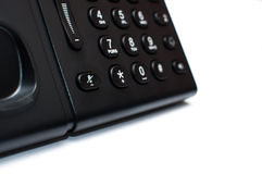 Buttons on a black desk phone. Black-white buttons on a stationery phone Stock Photo