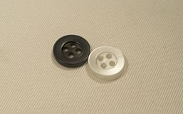 Buttons black and white. Buttons are small black and white, for fastening clothes Royalty Free Stock Images