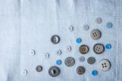 Buttons on the blue cloth top view Stock Photography